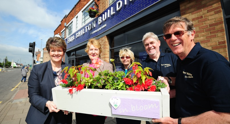 people outside earl shilton holding plants